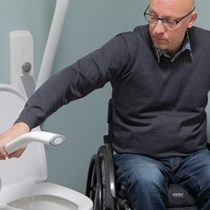 Toilet support arm wheelchair user
